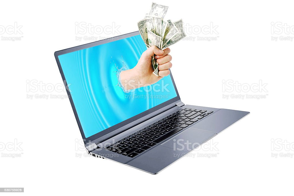 Getting money from laptop monitor screen stock photo