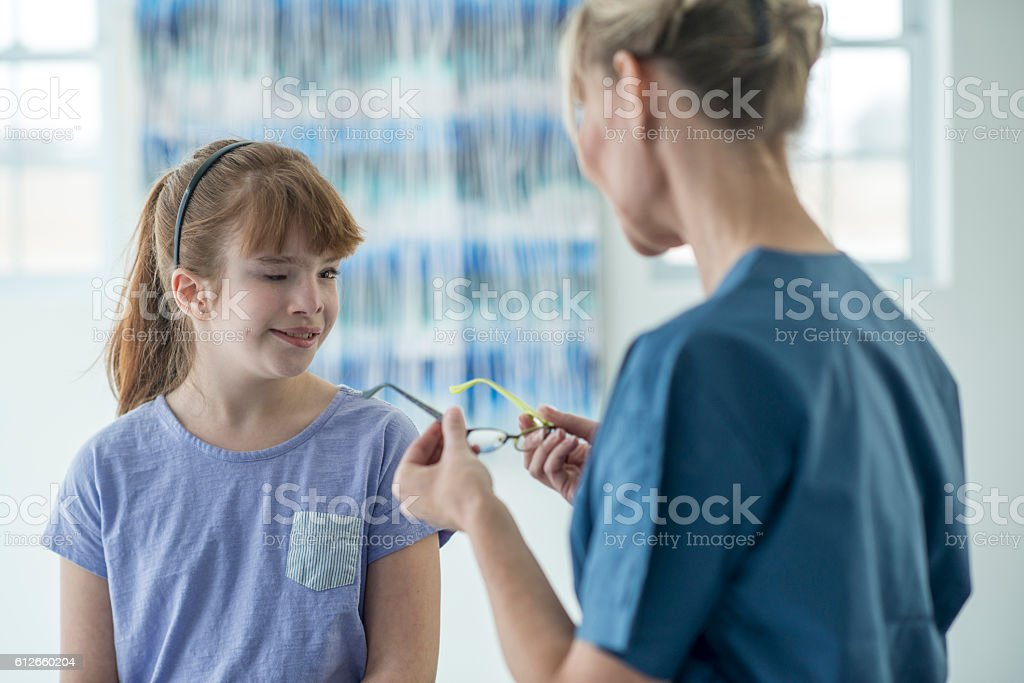 Getting New Glasses from the Optometrist stock photo