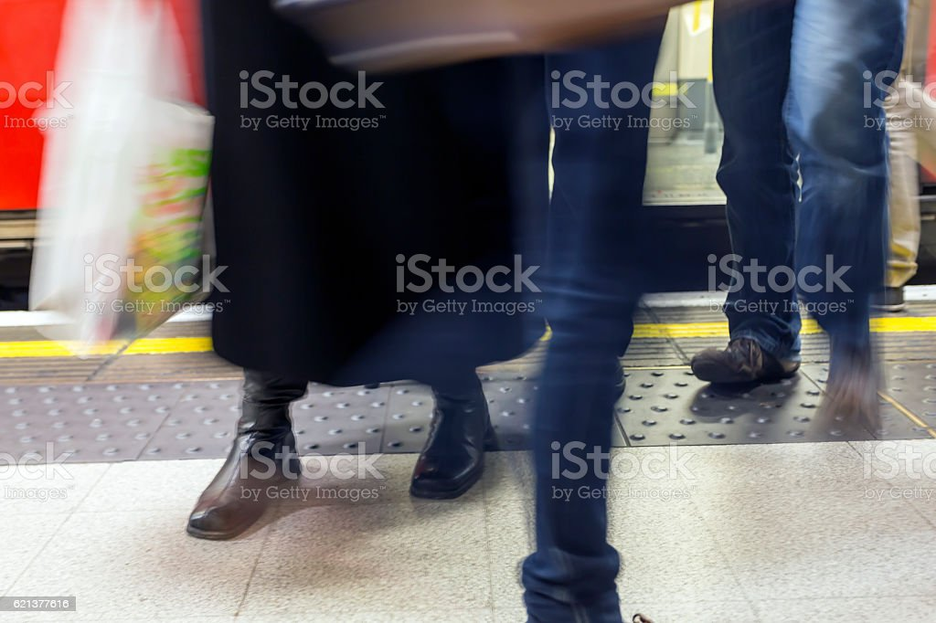 Getting off the tube in London stock photo