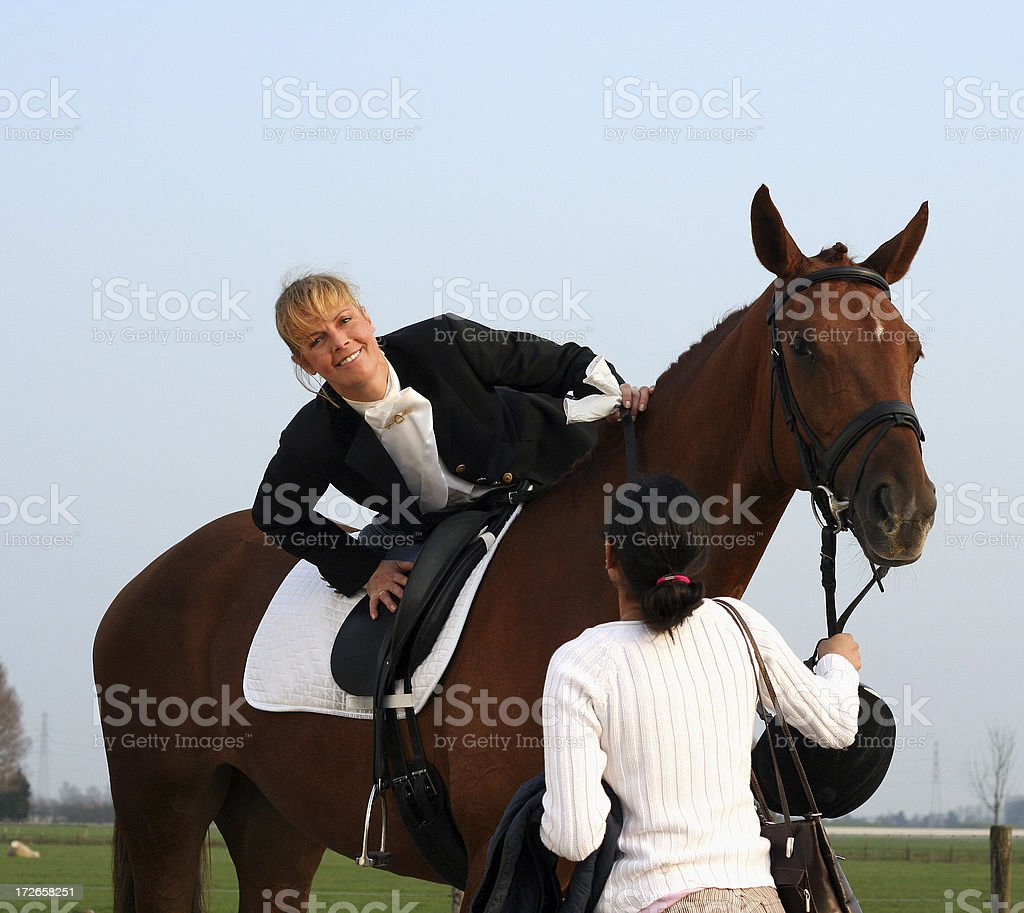 Getting off your horse stock photo