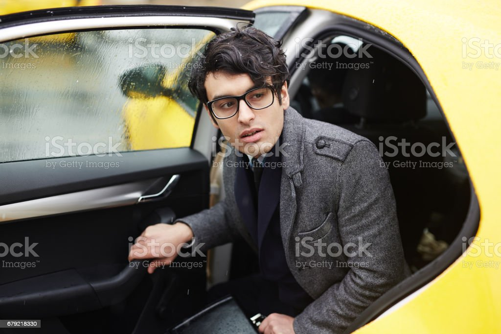 Getting out of taxi stock photo