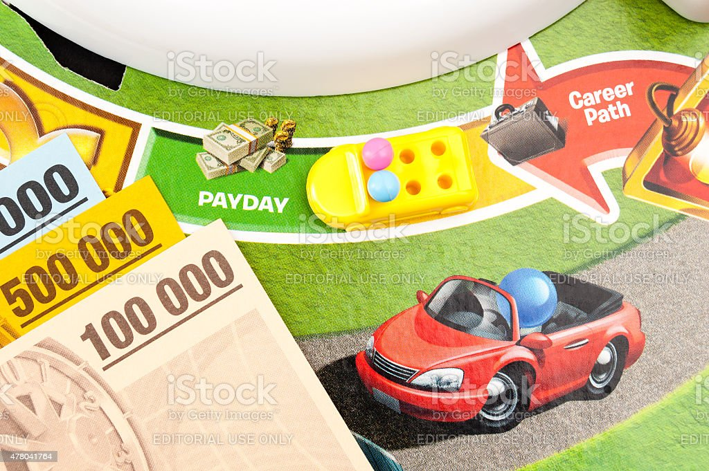 Getting paid in The Game of Life stock photo