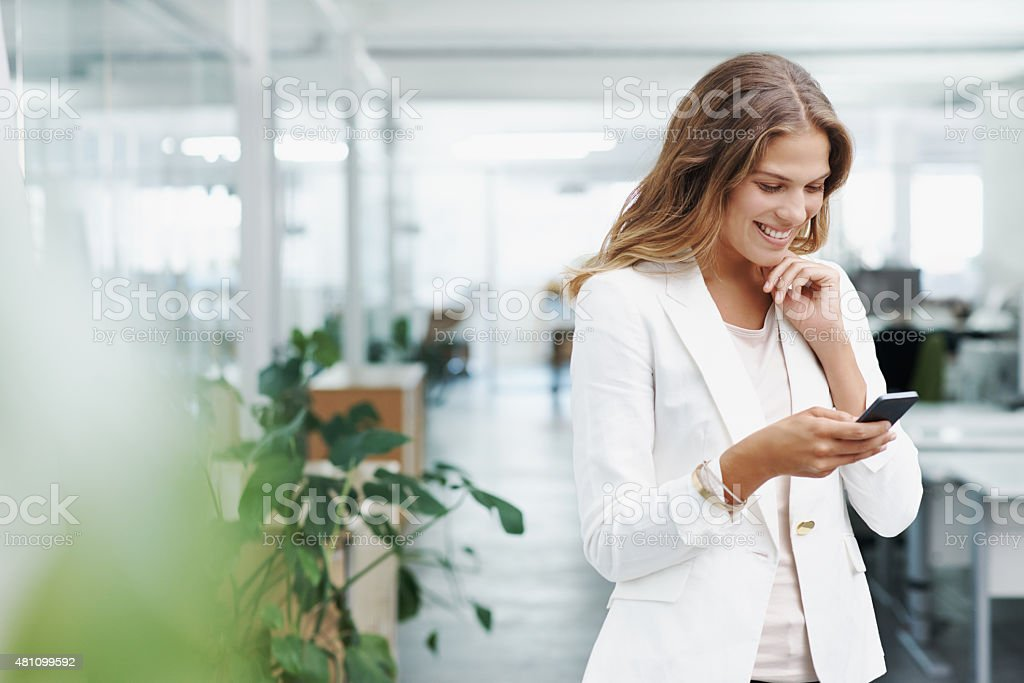 Getting positive feedback from a client made her day stock photo