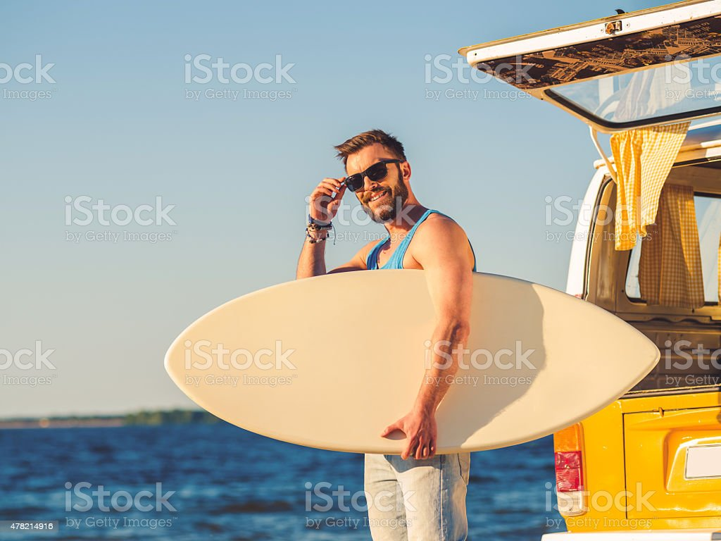 Getting ready for conquering the waves. stock photo