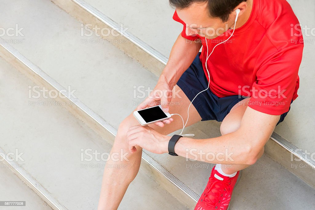 Getting ready for your daily workout with an activity tracker stock photo