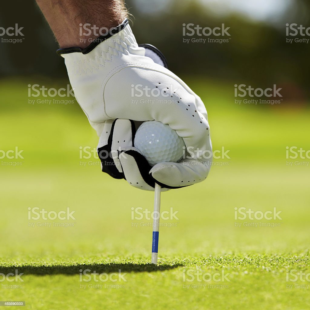 Getting ready to tee off stock photo