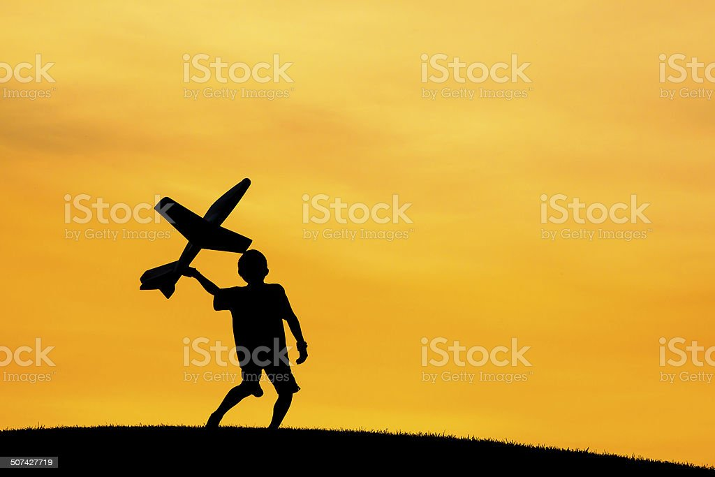 Getting ready to throw a toy plane. stock photo