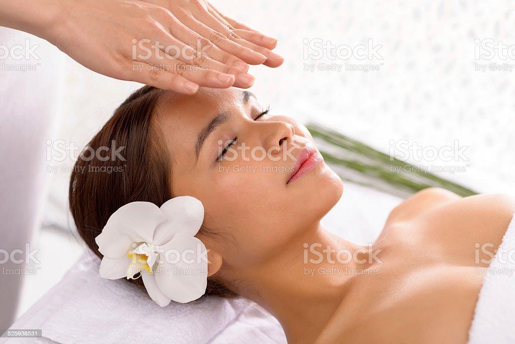 Getting reiki therapy stock photo