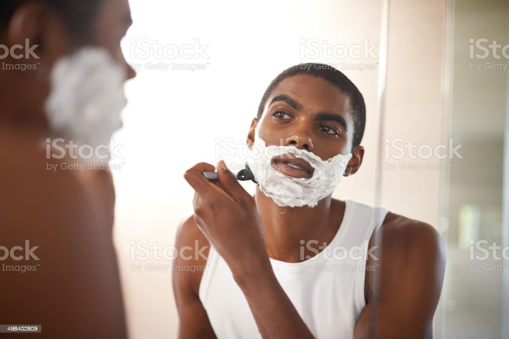 Getting rid of his stubble stock photo