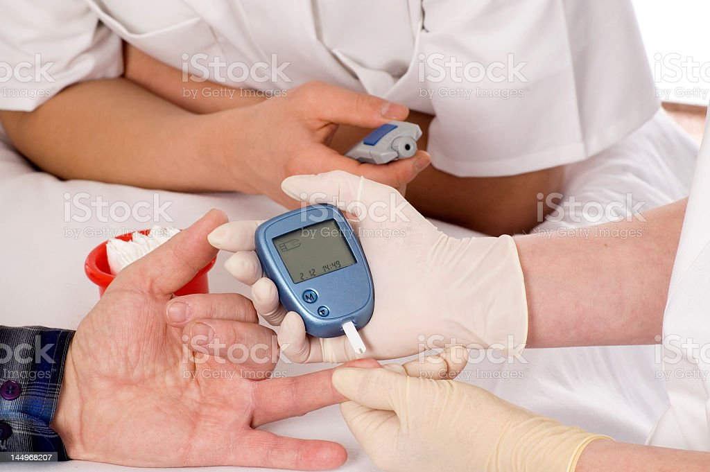 Getting s blood sugar test in the finger stock photo