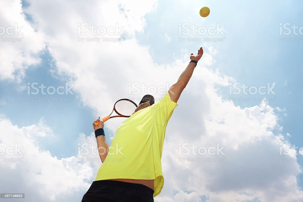 Getting some good elevation on his serve stock photo