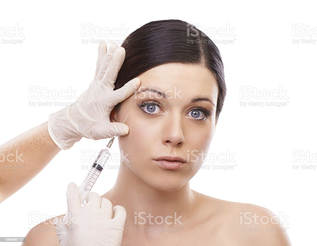 Getting some help with those wrinkles... royalty-free stock photo