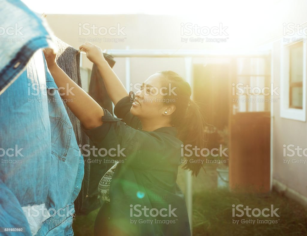 Getting some housework done stock photo