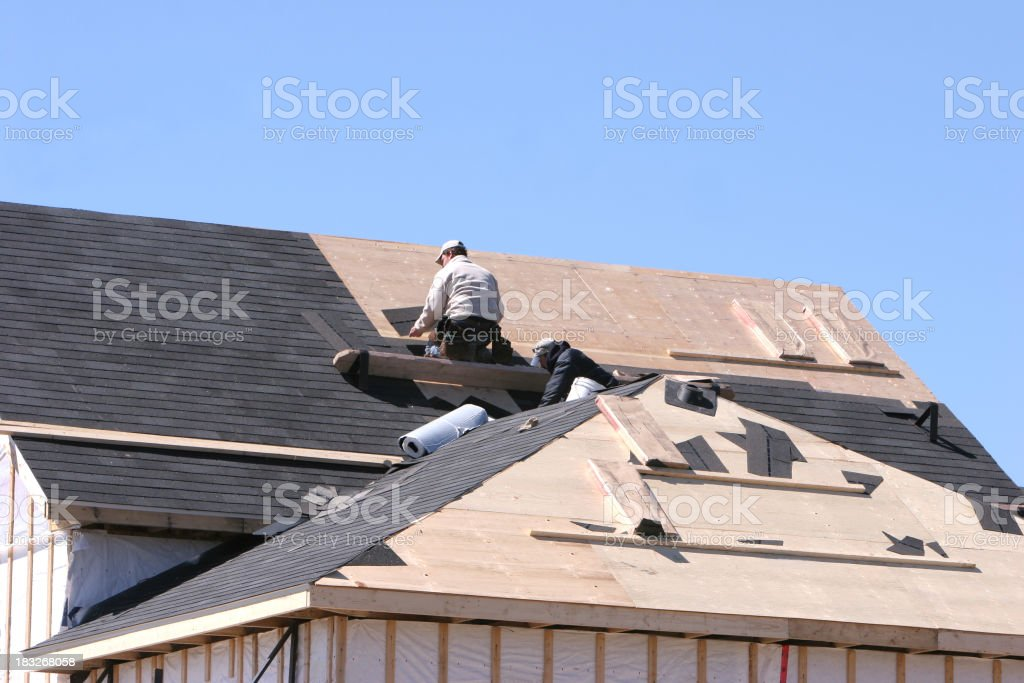 Getting the roof done stock photo