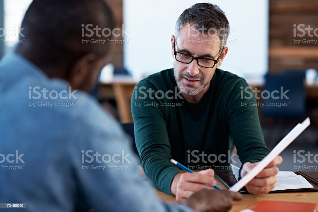 Getting their ideas in sync stock photo