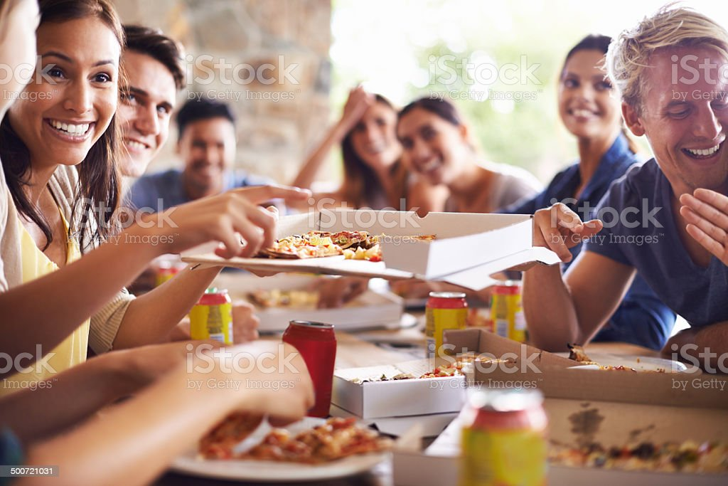 Getting together for pizza stock photo