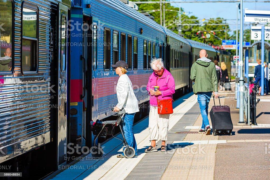 Getting walker on train stock photo