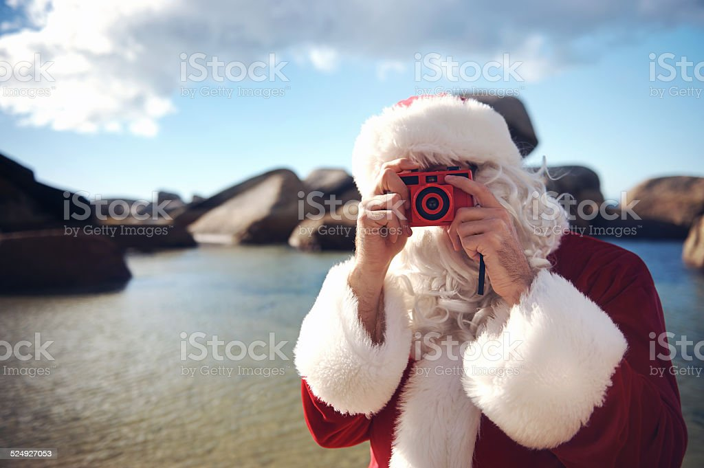 Getting your picture taken by Santa stock photo