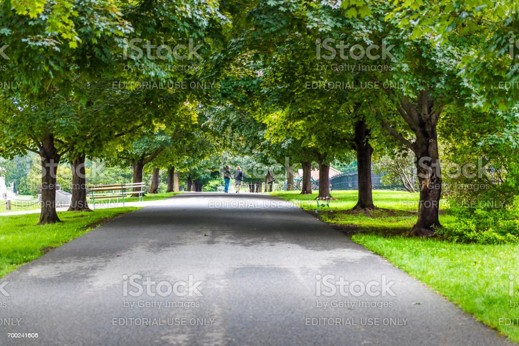 Gettysburg National Cemetery battlefield park with trail through maple trees and people stock photo