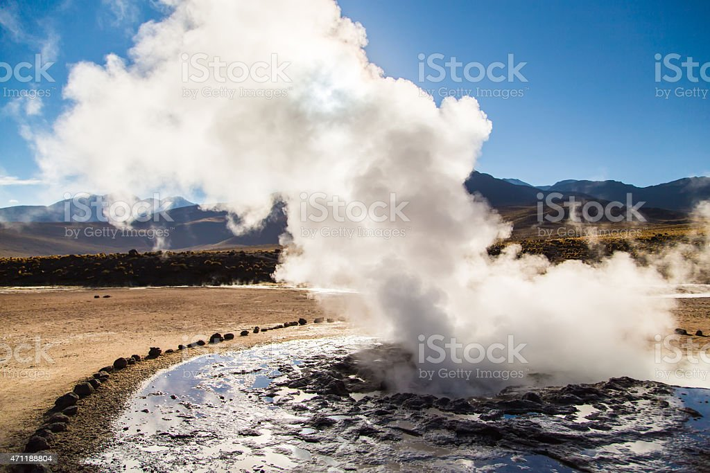 Geysers steaming in an amazing outdoor landscape stock photo