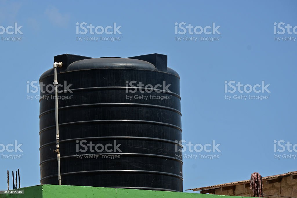 Ghana architecture - water tank on the roof stock photo