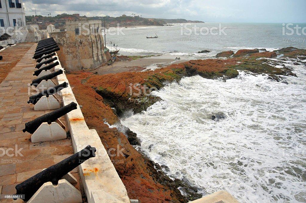 Ghana, Cape Coast: Gulf of Guinea, cannons and waves stock photo