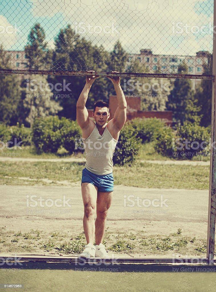 Ghetto street workout, vintage photo handsome man posing in urban...