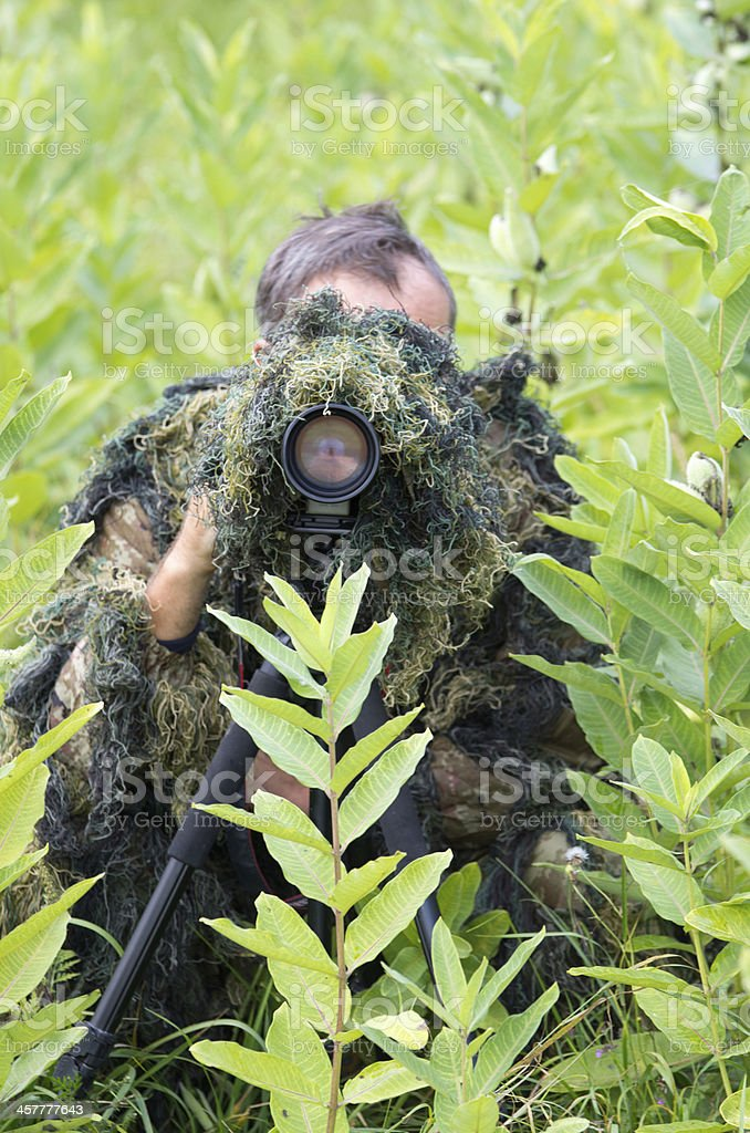 Ghillie suit stock photo