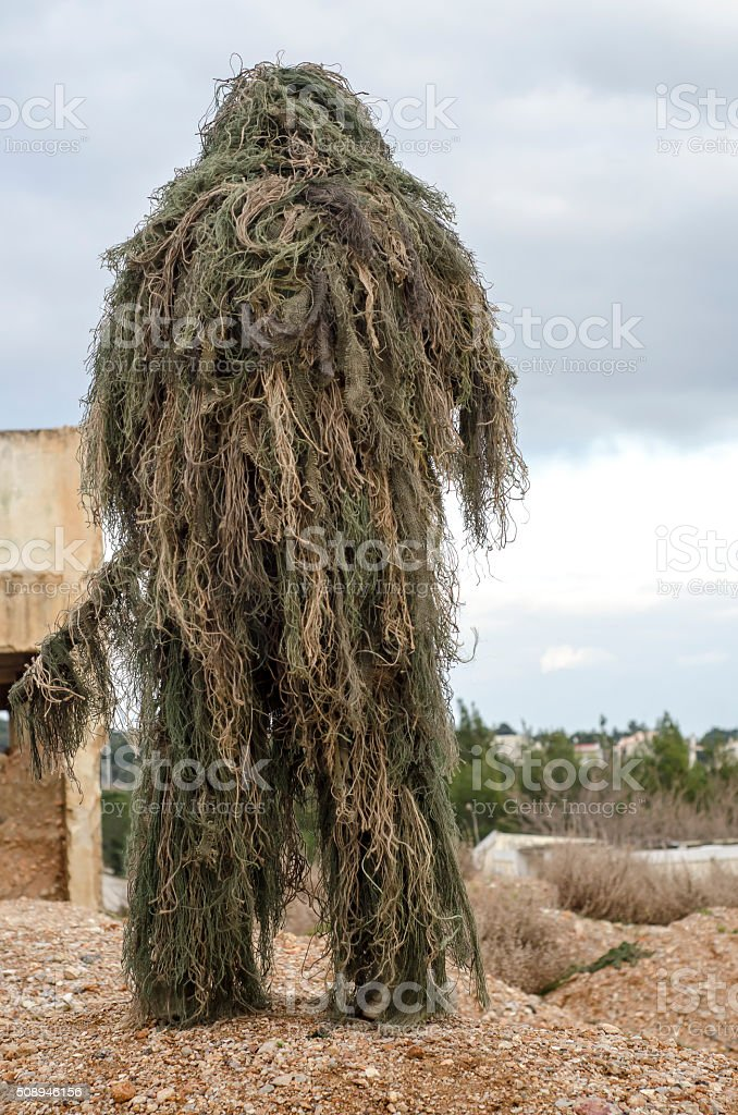 Ghillie suit sniper stock photo