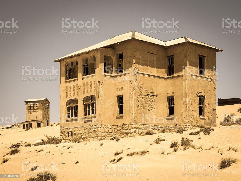 Ghost buildings of old diamond mining town Kolmanskop in Namibia stock photo