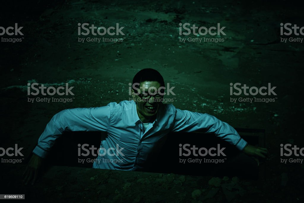 ghost climbed out of the ground stock photo