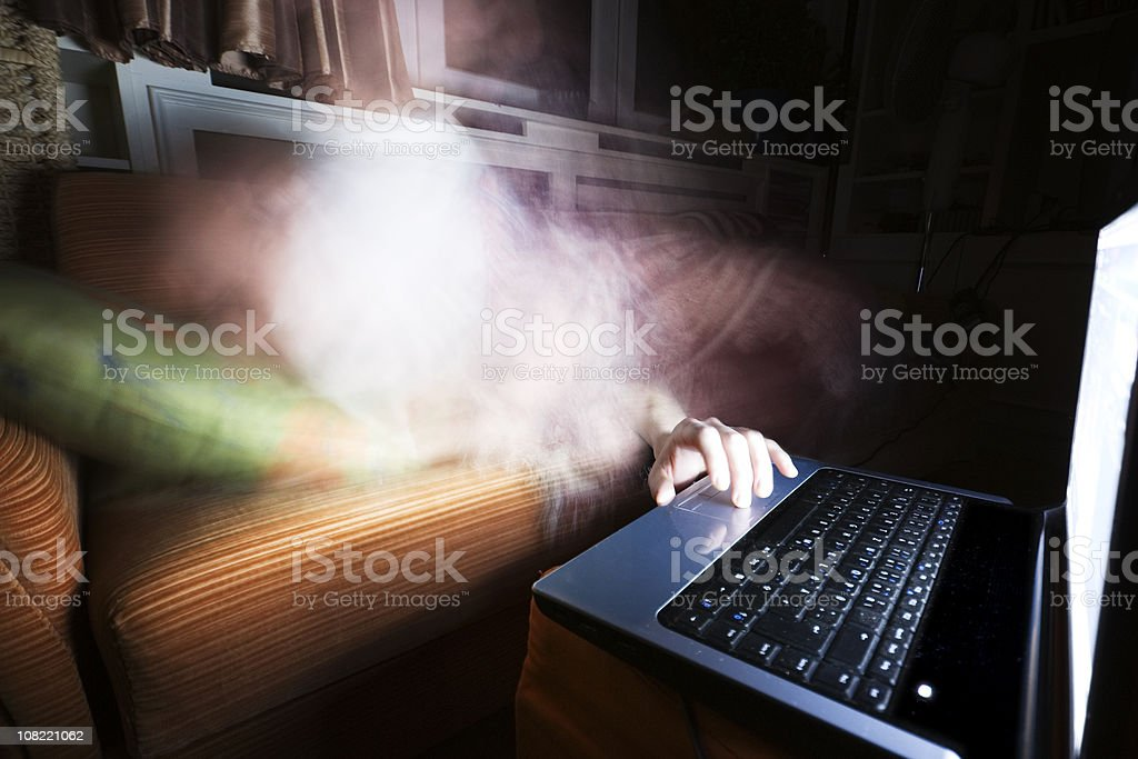 Ghost Hand Reaching Out For Laptop Computer royalty-free stock photo