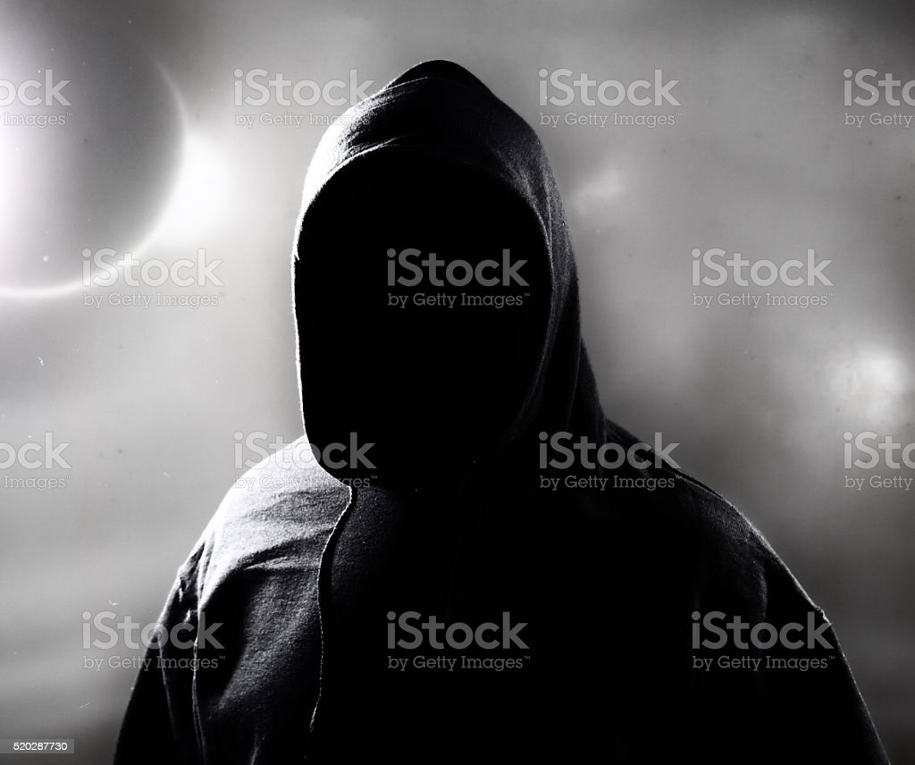 Ghost in hood stock photo