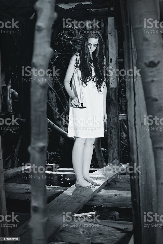 Ghost of woman in an abandoned house stock photo