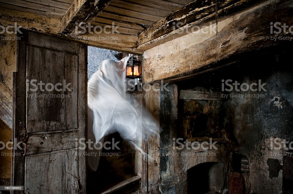 A ghost passing through the door in a old building stock photo