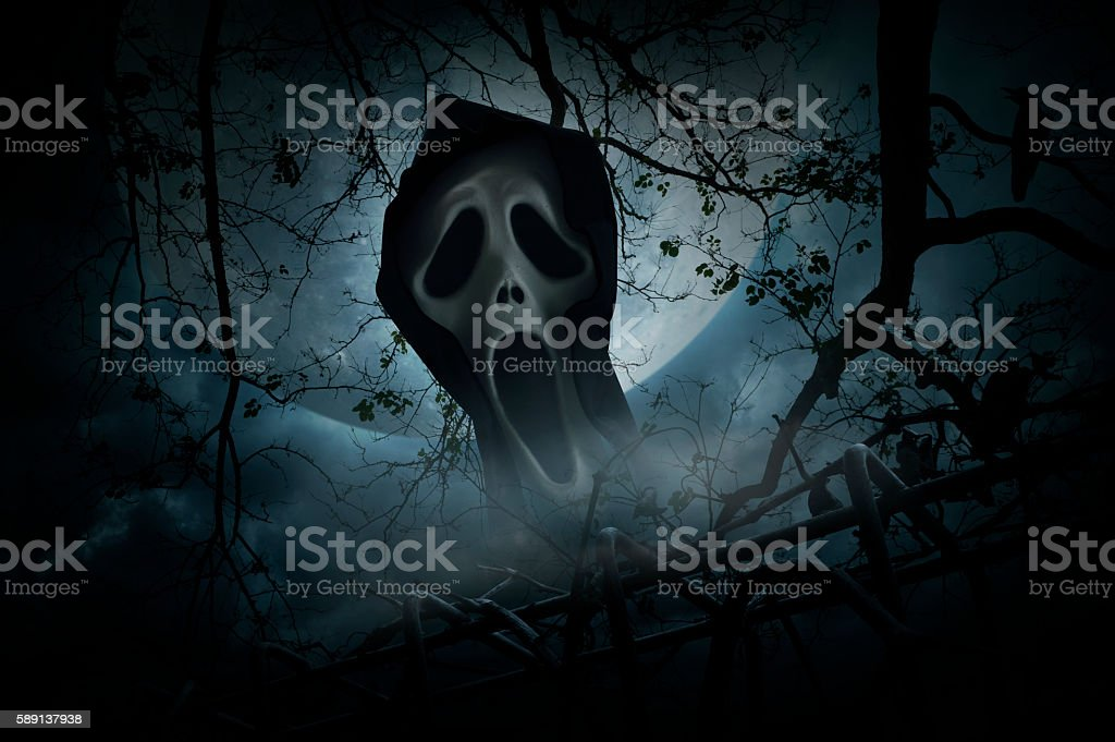 Ghost scream with fence over smoke and moon, Halloween concept stock photo