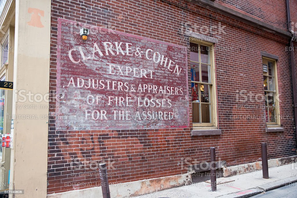 Ghost sign on building in Philadelphia, PA stock photo