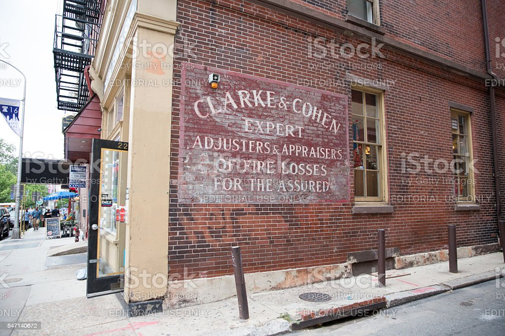 Ghost sign on side of building in Philadelphia, PA stock photo