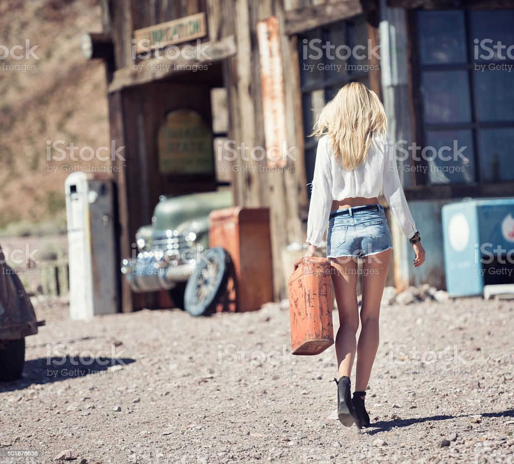 Ghost Town, Woman at a Gas Station stock photo