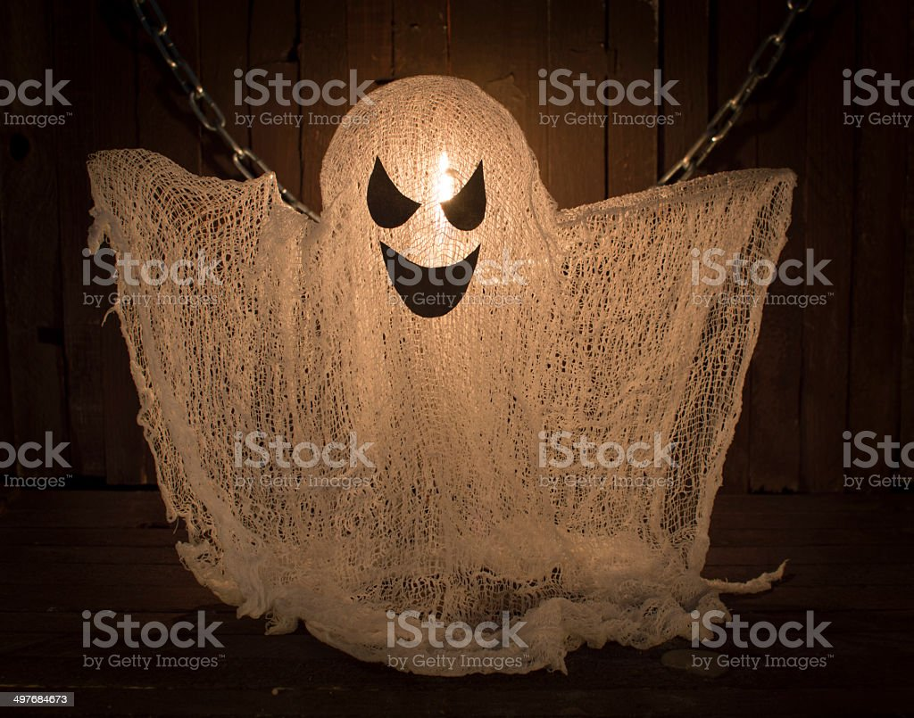 Ghost with candle in the darkness stock photo