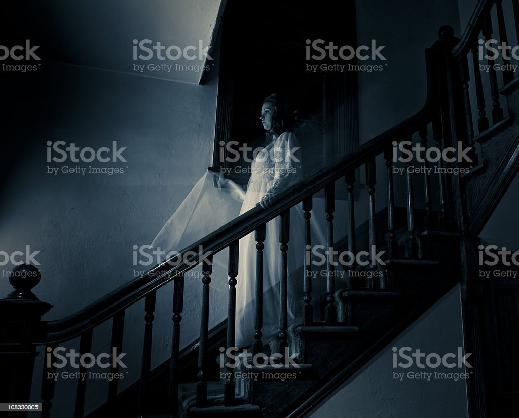 Ghost Woman on Haunted Staircase stock photo