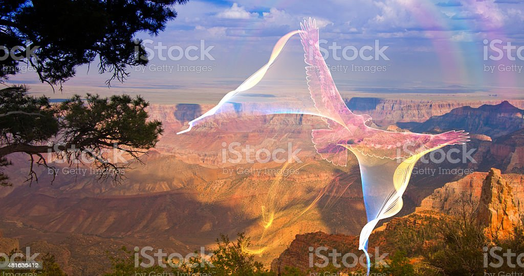 Ghostlike Eagle in flight above grand canyon rim stock photo