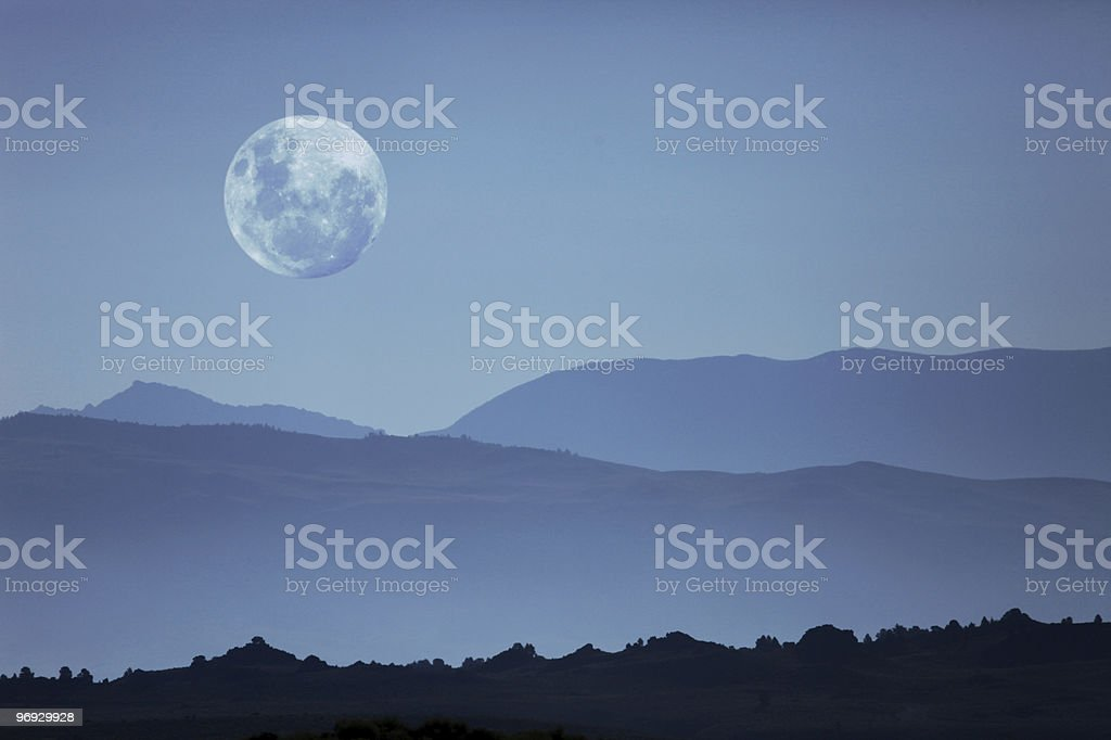 Ghostly Mountain Silhouettes and Moon stock photo
