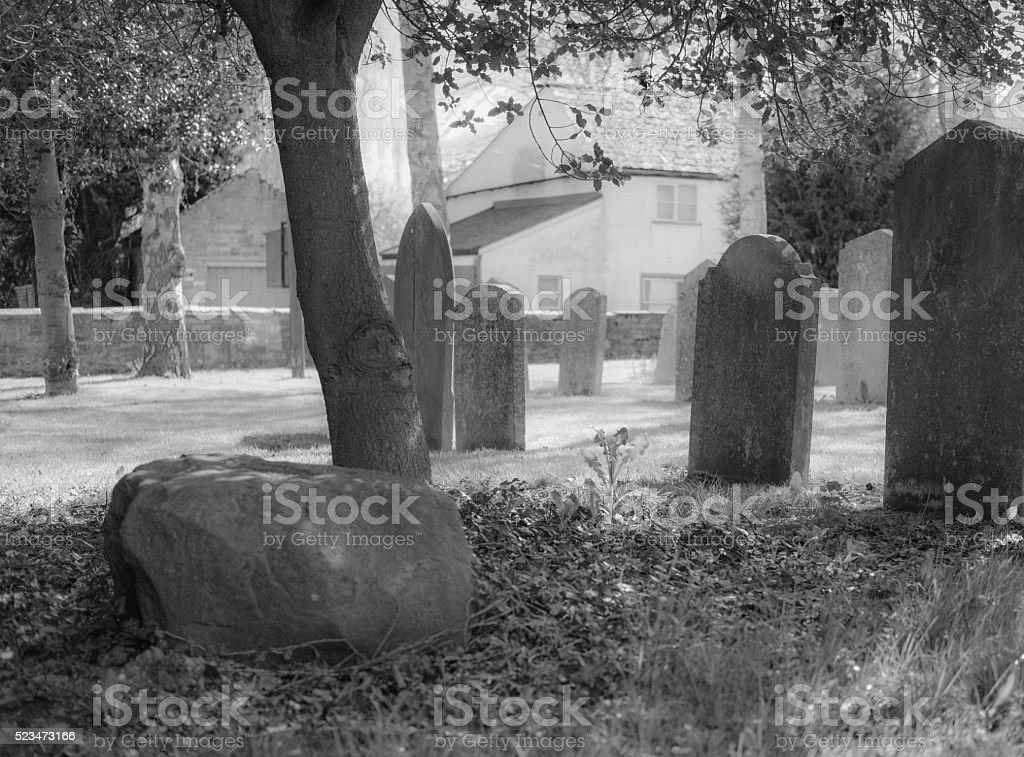 Ghostly scene in a village cemetery stock photo