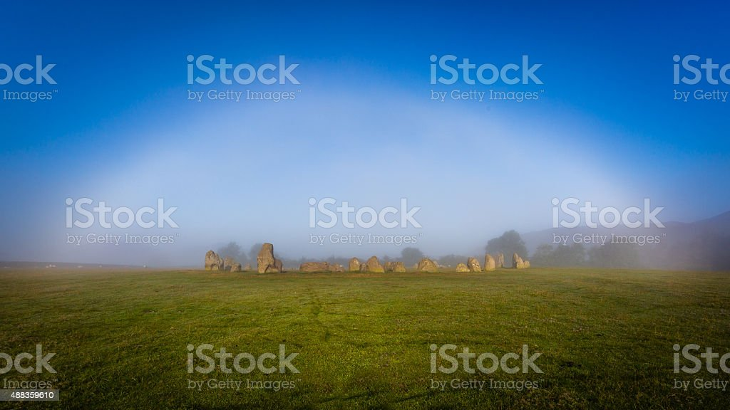 Ghostly white bow above Castlerigg Stone Circle. stock photo