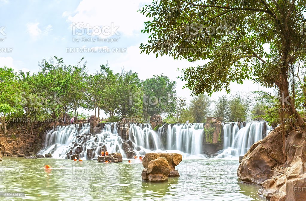 Giang Dien waterfall inside old trees stock photo