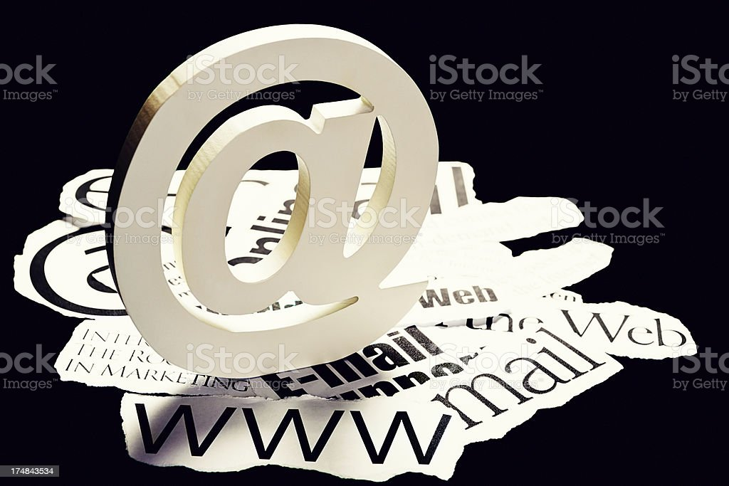 Giant 3-D @ sign on internet-related headlines royalty-free stock photo