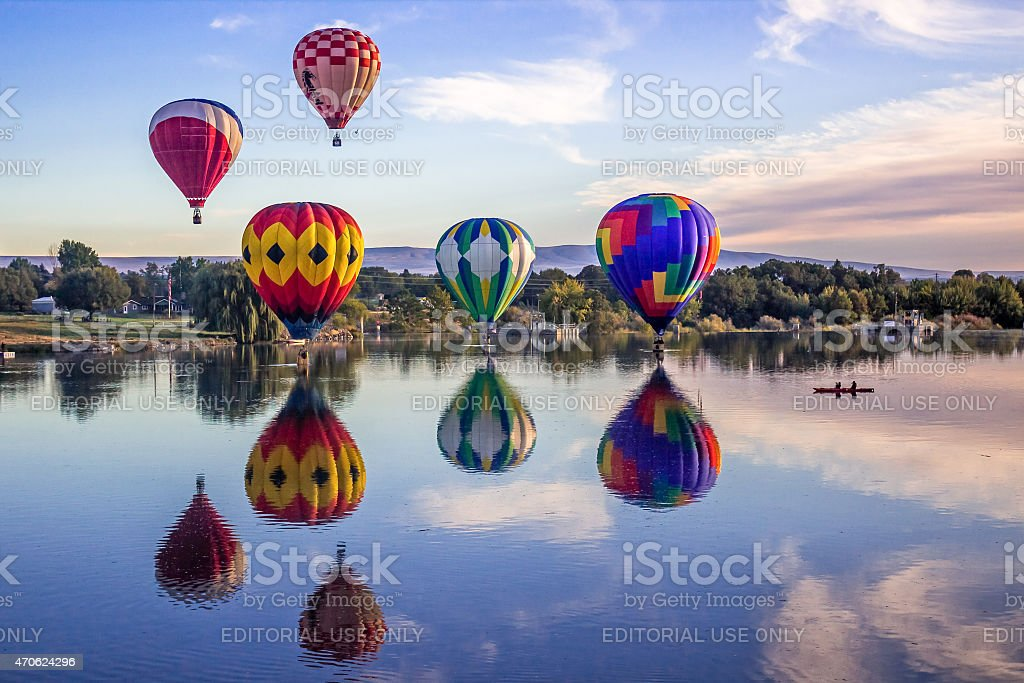 Giant balloons fly over Yakima river stock photo