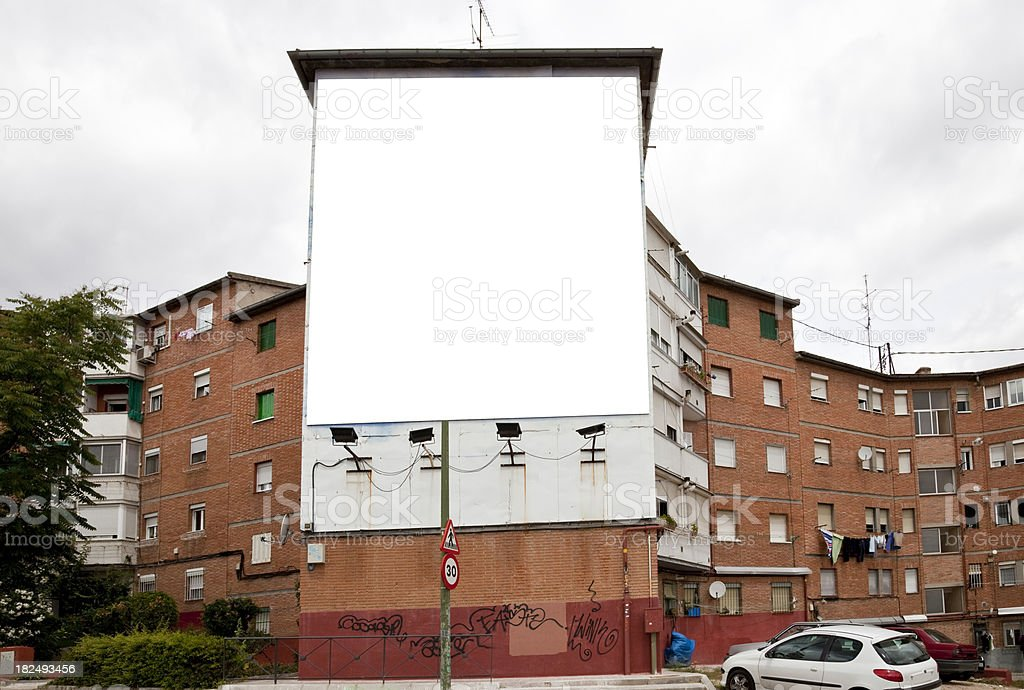 Giant billboard in facade of a poor building royalty-free stock photo