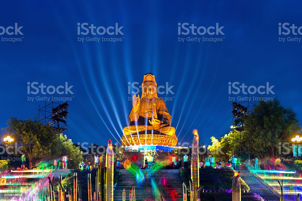 Giant Buddha (Kwan Yin) Sculpture at night stock photo